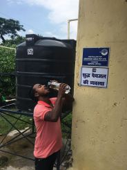 local person drinking water at Colony Purnea
